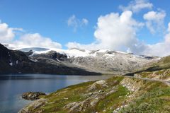 Scenic road along the fjords with mountains Stock Images