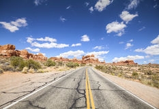 Scenic road with blue sky, Arches National Park, USA Royalty Free Stock Photography