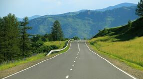 Scenic Road by Hills Stock Photo