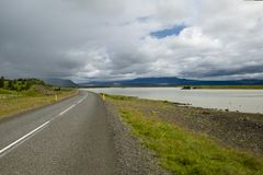 Scenic road in Iceland. Viewed in cloudy weather, typical for this country Royalty Free Stock Photo