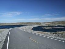 Scenic road among lakes stock photo