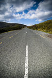 Scenic road in the mountains. Tarmac scenic road in Dublin Mountains Royalty Free Stock Photography
