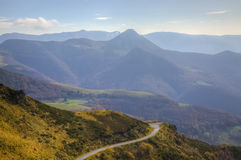 Scenic Road in Mountains. Misty morning view of a scenic road located in the volcanic Central Massif in France Royalty Free Stock Photography