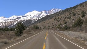 Scenic road through the mountains of Sierra Nevada. Travel photography stock video footage
