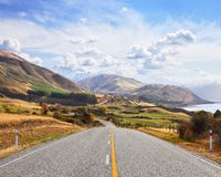 Scenic road near Lake Hawea in the sunny autumn day, South island, New Zealand stock photography