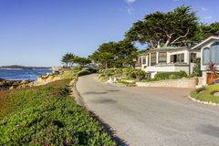 Driving on the Pacific Ocean coast, in Carmel-by-the-sea, Monterey Peninsula, California. Scenic road on the Pacific Ocean coast through a residential Stock Photo