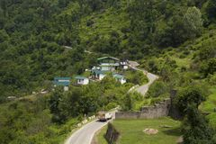 Scenic road to Auli with houses and mountain backdrop. Chamoli district Uttarakhand, India royalty free stock images