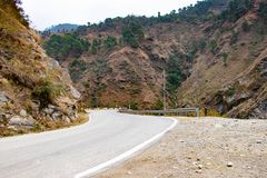 Scenic road through the valley of banikhet dalhousie himachal pradesh covered with mountain and trees. Driving uphill scenic road. Travel concept royalty free stock images