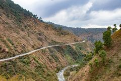 Scenic road through the valley of banikhet dalhousie himachal pradesh covered with mountain and trees. Driving uphill scenic road. Travel concept royalty free stock photos