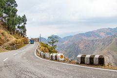 Scenic road through the valley of banikhet dalhousie himachal pradesh covered with mountain and trees. Driving uphill scenic road. Travel concept royalty free stock photography
