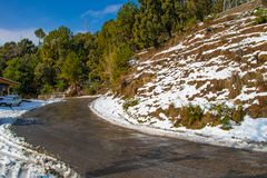 Scenic road through the valley of banikhet dalhousie himachal pradesh covered with Snow mountain and trees. Driving uphill scenic. Road winter travel concept royalty free stock photography