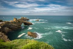 Scenic rocher de la vierge on atlantic coastline in colorful amazing seascape, Biarritz, Basque Country, France Royalty Free Stock Image
