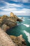 Scenic rocher de la vierge on atlantic coastline in colorful amazing seascape, Biarritz, Basque Country, France Stock Images