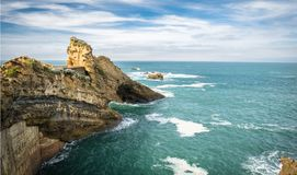 Scenic rocher de la vierge on atlantic coastline in colorful amazing seascape, Biarritz, Basque Country, France Royalty Free Stock Photography