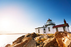 Scenic rock formations with West Point Lighthouse Stock Image