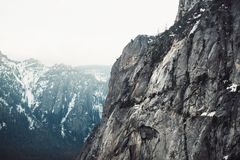 Scenic rock mountain top with fog at winter time in Yosemite National Park Royalty Free Stock Photos