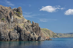 Scenic rock at the sea coast - view from water. Beauty of nature Stock Photo