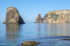 Scenic rocks and blue calm sea. Royalty Free Stock Images