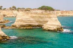 Scenic rocky cliffs of Torre Sant Andrea, Salento, Italy Royalty Free Stock Photos