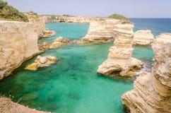 Scenic rocky cliffs of Torre Sant Andrea, Salento, Italy Stock Image