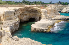 Scenic rocky cliffs of Torre Sant Andrea, Salento, Italy Stock Images