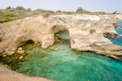 Scenic rocky cliffs of Torre Sant Andrea, Salento, Italy Royalty Free Stock Photo