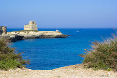 Scenic rocky cliffs on the waterfront of Salento. Rocky cliffs on the coast between Roca and Torre dell'Orso in Salento Stock Photos