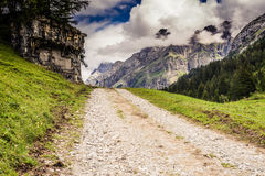 Scenic Rocky Dirt Road Leading Through Mountains Royalty Free Stock Photo