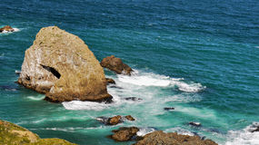 Scenic Rocky Sea Shore. Rocks rising from the sea Stock Images