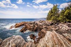 Scenic rocky shoreline in La Verna Preserve. In Bristol, Maine, on a beautiful summer day Stock Image