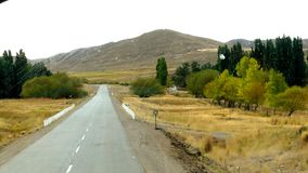 Scenic route landscape. Vanishing point green trees ruta 40 Argentina stock image