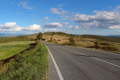 Scenic rural road in Tuscany Stock Photo