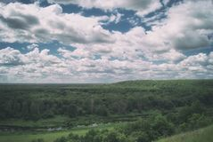 Scenic Russian Landscape. Meadows, river and hills under a cloudy sky.  Stock Photos