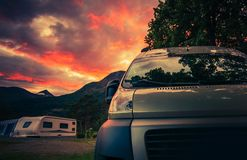 Scenic RV Park Camping. During Beautiful Summer Sunset. Motorhome and Travel Trailers in the Background stock image