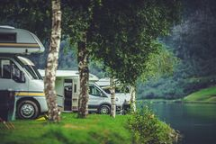 Scenic RV Park Camping. Lakefront Campsite. Vacation in Recreational Vehicle royalty free stock photos