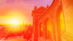 Scenic San Luca Sanctuary. Scenic landscape of courtyard with the light of the sunset and of the side view of the Sanctuary of Madonna di San Luca. The church of stock video