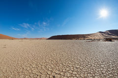 Free Scenic Sand Dunes And Cracked Clay Pan In Sossusvlei, Namib Naukluft National Park, Best Tourist And Travel Attraction In Stock Photos - 77549883