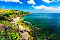 Scenic sea landscape, Bali. High cliff on tropical Pantai beach in Bali, Indonesia. Tropical nature of Bali, Indonesia. Beautiful blue sea water, white sand royalty free stock photography
