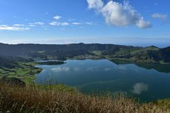 Hills and Clouds Reflecting in a Lake Caldeira. Scenic Sete Cidades on Sao Miguel in the Azores royalty free stock images