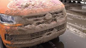 Car with snow on it. A  scenic shot of a car coated with snow stock footage