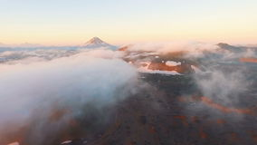 Scenic shot of a lake with morning fog, and a mountain in the background at sunrise. Aerial View. Scenic shot of a lake with morning fog, and a mountain in the stock video
