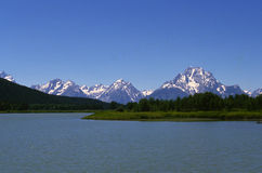 Scenic shot of Tetons with lake in foreground Stock Photos