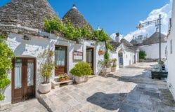 Scenic sight in Alberobello, the famous Trulli village in Apulia, southern Italy. Royalty Free Stock Photo