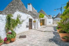 Scenic sight in Alberobello, the famous Trulli village in Apulia, southern Italy. Royalty Free Stock Image
