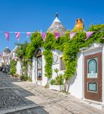 Scenic sight in Alberobello, the famous Trulli village in Apulia, southern Italy. Royalty Free Stock Images