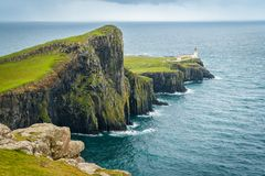 Scenic sight of Neist Point Lighthouse and cliffs in the Isle of Skye, Scotland. Neist Point is a viewpoint on the most westerly point of Skye. Neist Point royalty free stock photos