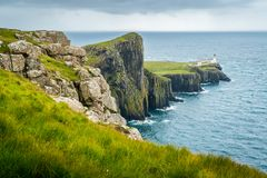 Scenic sight of Neist Point Lighthouse and cliffs in the Isle of Skye, Scotland. Neist Point is a viewpoint on the most westerly point of Skye. Neist Point stock photo