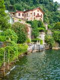 Scenic sight in Torno, colorful and picturesque village on Lake Como. Lombardy, Italy. royalty free stock photos