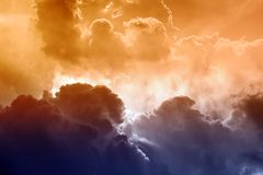 Scenic sky. Dramatic background - bright sun light, dark clouds Royalty Free Stock Photography