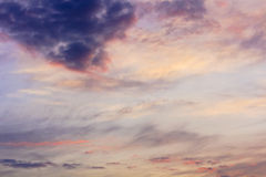 Scenic sky with clouds of different shapes at sunset Royalty Free Stock Images